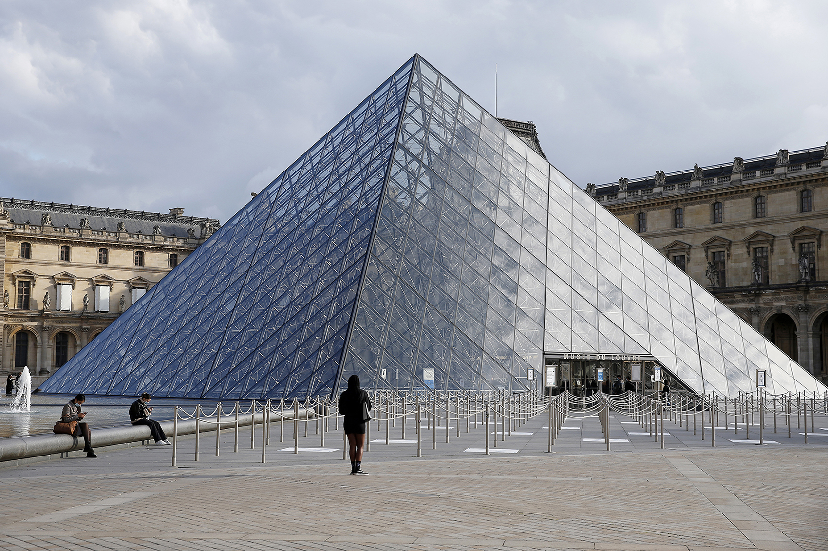 The almost empty courtyard of the Louvre museum and the pyramid of Louvre are seen without tourists on October 14, 2020 in Paris