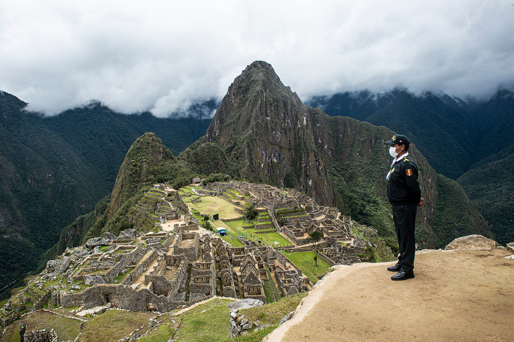 A tourist policeman is seen on duty at the archaeological site of Machu Picchu, in Cusco, Peru