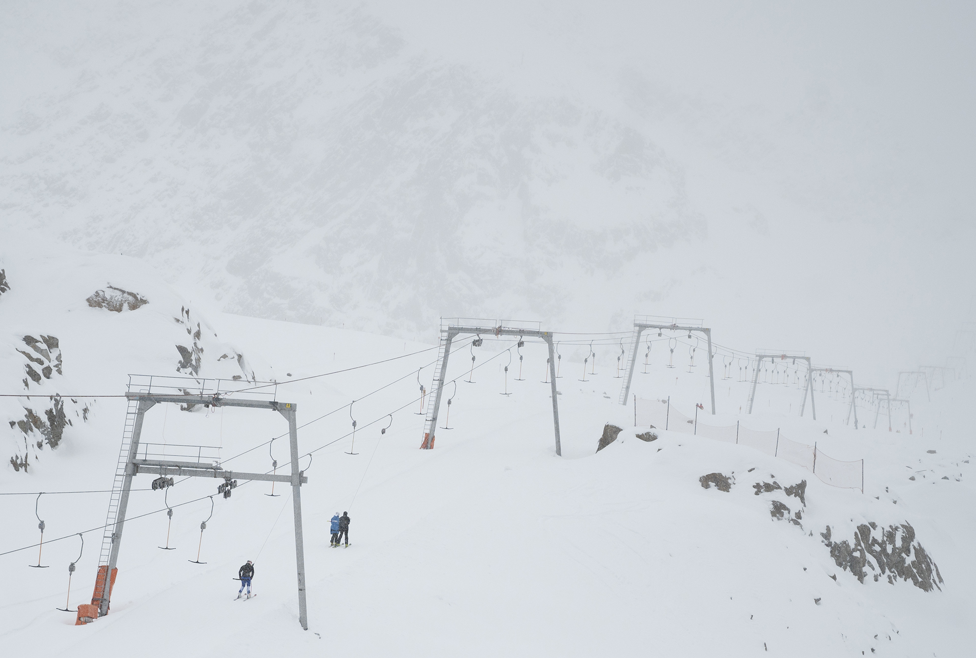 A handful of skiers take their ride empty ski lift at Pitztal glacier, Austria