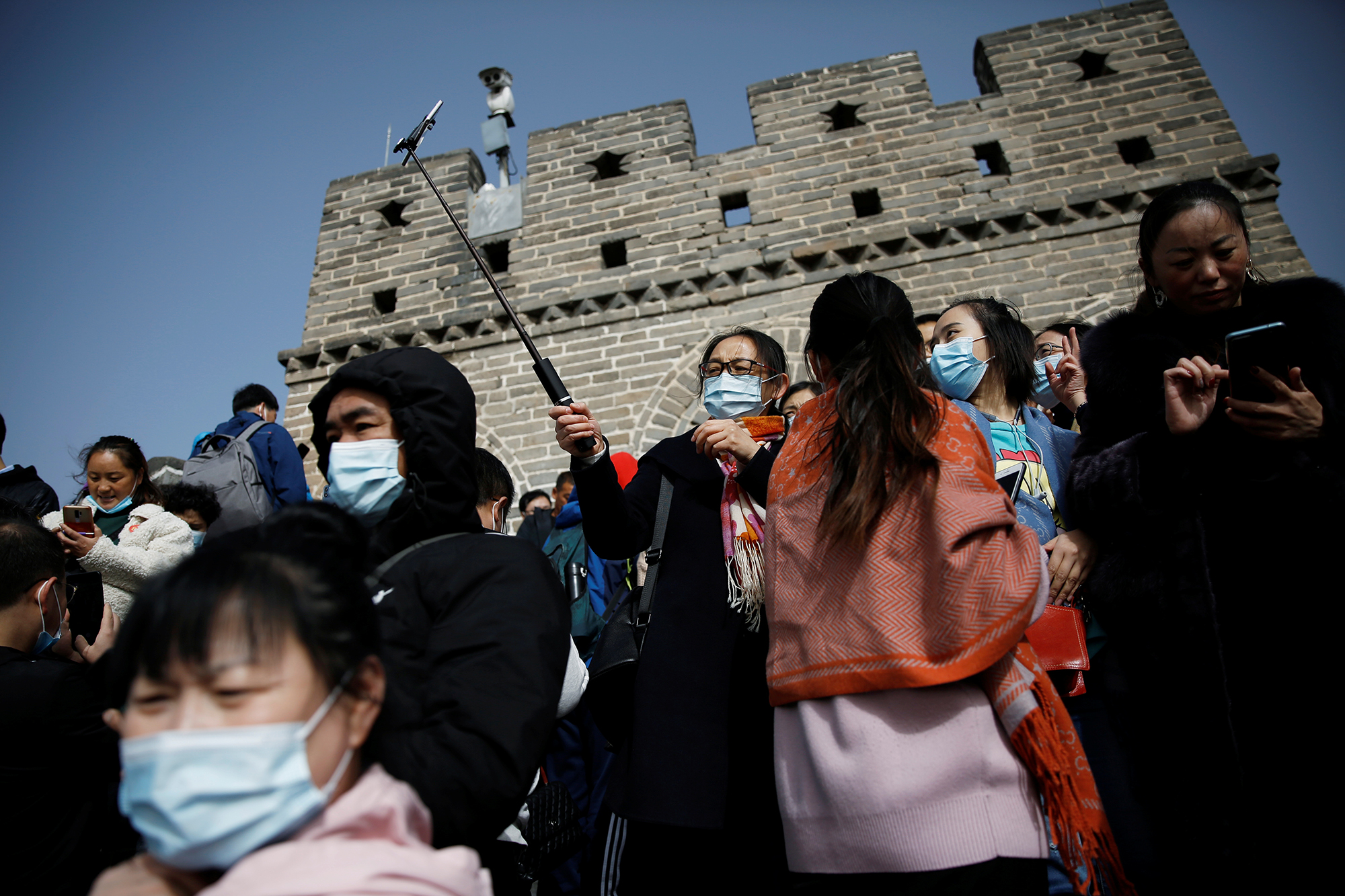 Visitors wearing masks, following the coronavirus disease (COVID-19) outbreak, are seen at the Badaling section of the Great Wall in Beijing, China