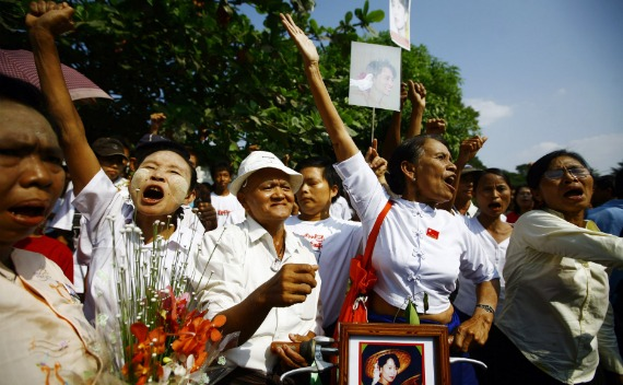 Members of the National League for Democracy (NLD) party shout during a protest outside the house of their leader, Aung San Suu Kyi, in Yangon on November 13, 2010.