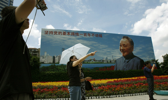 Visitors stand in front of a portrait of the late Chinese leader Deng in the southern Chinese city of Shenzhen.