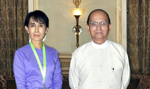 Mynamar's Aung San Suu Kyi meets President Thein Sein at the presidential palace in Naypyitaw.