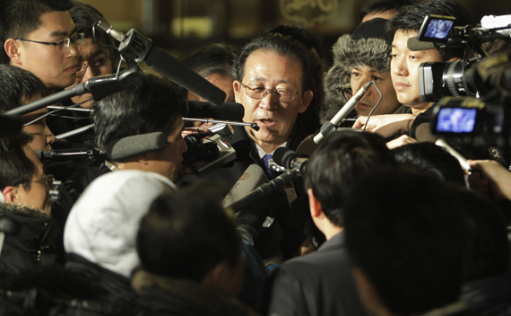 North Korea's envoy to the six-party talks Kim Kye-gwan (C) speaks to the media after a meeting with a Chinese foreign ministry counterpart in Beijing, February 11, 2010.