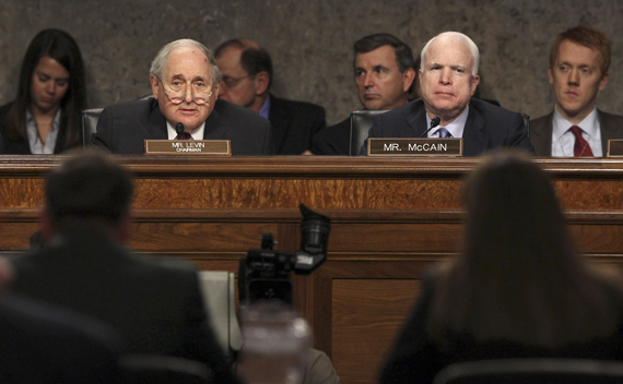 U.S. General David Petraeus and Flournoy speak to Levin and McCain at a Senate hearing on Capitol Hill in Washington.