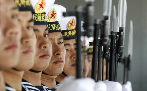 Chinese sailors stand guard onboard the Shi Jia Zhuang, a Luzhou class missile destroyer, at Valparaiso port, about 75 miles (121km) northwest of Santiago November 23, 2009. Two Chinese vessels docked at Valparaiso on Monday as the navies from both countries sought to exchange experiences as well as strengthen cooperation between each other. REUTERS/Eliseo Fernandez