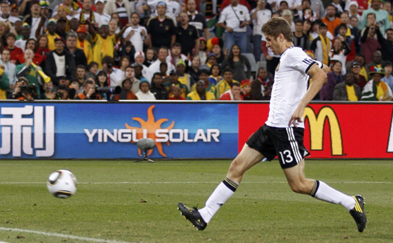 Germany's Thomas Mueller shoots to score his team's fourth goal against England during a 2010 World Cup second round soccer match at Free State stadium in Bloemfontein June 27, 2010.