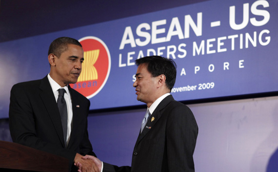 U.S. President Obama shakes hands with Thailand's PM Abhisit after  the ASEAN-US Leaders Meeting at the APEC Summit in Singapore