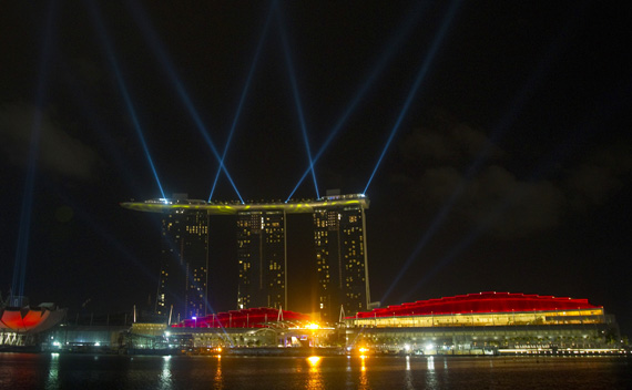 Searchlights beam off the site of the Marina Bay Sands integrated resort in Singapore