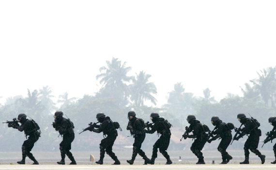 Members of the Indonesian police elite anti-terrorist unit take part in a drill at Sukarno-Hatta airport in Jakarta