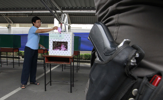 A policeman stands guard at a polling station in Bangkok July 25, 2010.
