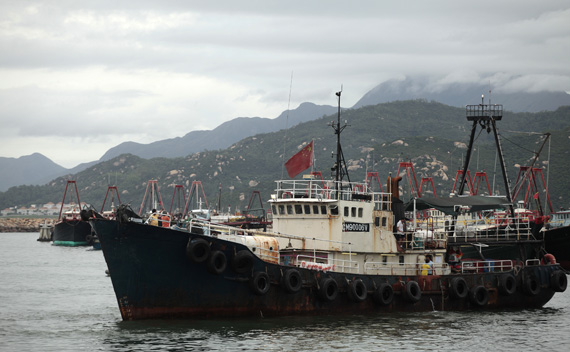 Activists on a fishing boat depart for the disputed Senkaku or Diaoyu islands from an island in Hong Kong