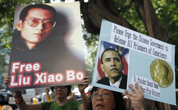 A demonstrator holds a picture of Chinese dissident Liu Xiaobo during a protest, urging Nobel peace prize recipient U.S. President Barack Obama to demand the Chinese government to release all dissidents, outside the U.S. Consulate General in Hong Kong October 23, 2009. REUTERS/Tyrone Siu