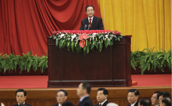 China's Premier Wen Jiabao (top) delivers a speech on a stage as other Chinese top leaders are seen at a reception marking the 61st anniversary of China at the Great Hall of the People in Beijing September 30, 2010. China celebrates its National Day on October 1.