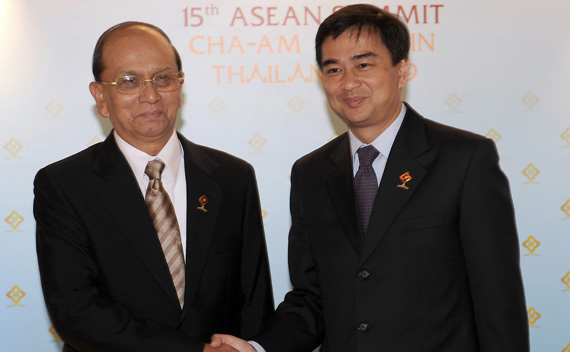 Thailand's PM Abhisit shakes hand with Myanmar's PM Thein during the 15th ASEAN Summit and related summits in Hua Hin