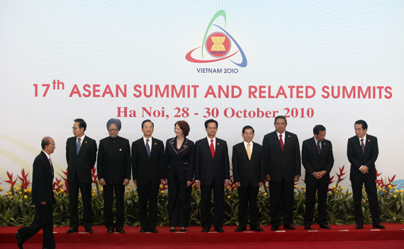 Myanmar's Prime Minister Thein walks on as other ASEAN and East Asian leaders wait for their group photo session during the 17th ASEAN Summit in Hanoi
