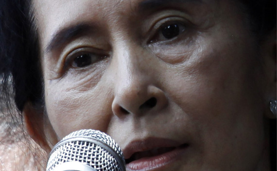 Aung San Suu Kyi addresses supporters outside the headquarters of her National League for Democracy party in Yangon