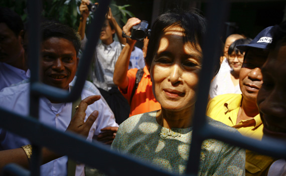 Myanmar's pro-democracy leader Suu Kyi is greeted by supporters at her National League for Democracy's party headquarters in Yangon