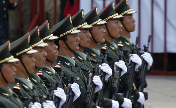 Chinese soldiers, invited by Mexico's Defense Ministry, take part in a military parade in culmination of bicentennial celebrations in Mexico City