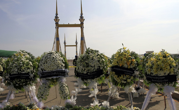Wreaths of flowers are placed near the scene of a stampede in Phnom Penh