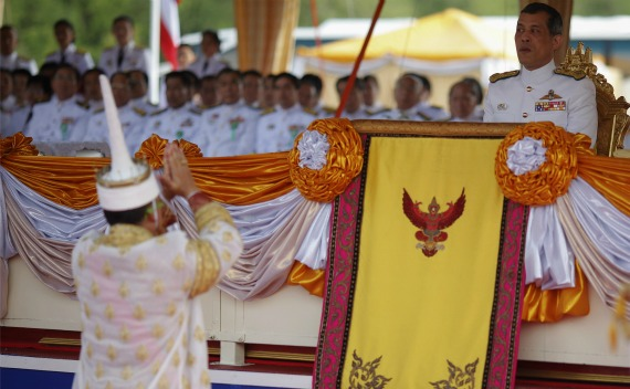A Thai official dressed in a traditional costume greets Thailand's Crown Prince Maha Vajiralongkorn (R) during an annual royal ploughing ceremony in cental Bangkok on May 13, 2011.