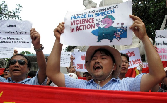 Protesters march with banners and placards during an anti-China demonstration on a street in Hanoi on June 19, 2011. Several dozen Vietnamese protested in front of the Chinese embassy and marched through Hanoi for the third Sunday running after Beijing sent one of its biggest maritime patrol ships into the disputed waters of the South China Sea.