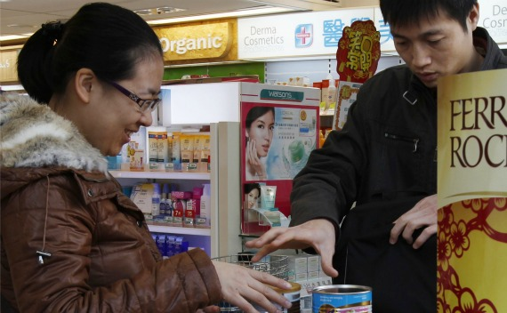 A married couple from Shenzhen puts cans of milkpowder they bought for their baby into a backpack at a drug store at Hong Kong's northern rural Sheung Shui district, neighbouring Shenzhen on January 31, 2011. China food safety concerns and a strong currency are prompting a flood of Chinese parents to sweep supplies of milk powder from Hong Kong shop shelves, triggering citywide shortages and angering parents.