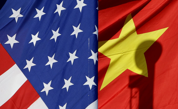National flags of the U.S. and China are seen in front of an international hotel in Beijing