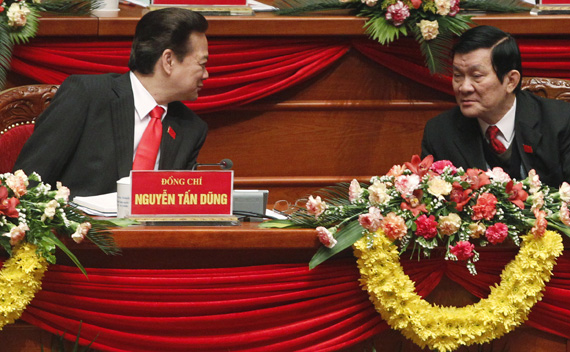 Vietnam's Prime Minister Dung chats with senior Politburo member Sang while attending the closing ceremony of the 11th National Congress of the Party in Hanoi