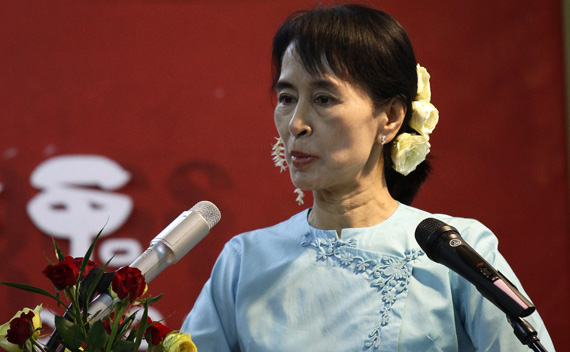 Myanmar's pro-democracy leader Aung San Suu Kyi addresses crowd during a ceremony to mark 63rd Independence Day at NLD head office in Yangon