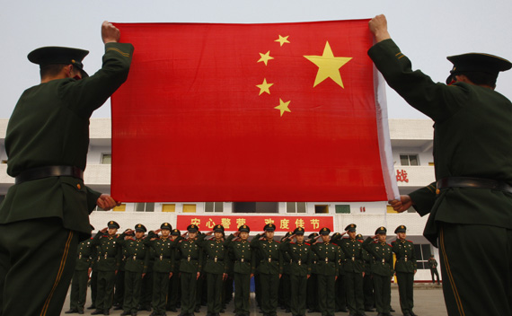 Add to cart   Add to lightbox (The Chronicle - February Cover Options) Download layout (Watermarked) Paramilitary police recruits take an oath in front of a Chinese national flag during a military rank conferral ceremony at a military base in Suining