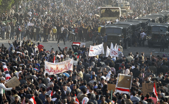 Pro-government demonstrators face-off against anti-Mubarak supporters near Tahrir Square in Cairo