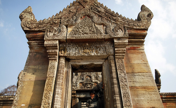 A Cambodian soldier smokes a cigarette at the 11th-century Preah Vihear temple on the border between Thailand and Cambodia