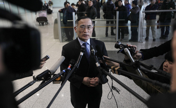 South Korea's chief nuclear envoy Wi Sung-lac speaks to the media at Beijing airport
