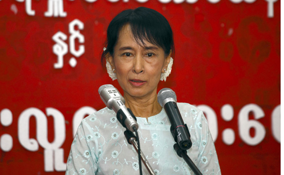 Myanmar's pro-democracy leader Aung San Suu Kyi speaks with youths at the National League for Democracy head office in Yangon