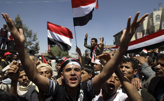 Anti-government protesters shout slogans during a protest demanding the ouster of Yemen's President Ali Abdullah Saleh outside Sanaa