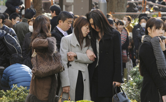 Evacuees stand around Shinjuku Central Park in Tokyo Japan March 11, 2011. A massive 8.9 magnitude quake hit northeast Japan on Friday, causing many injuries, fires and a ten-metre (33-ft) tsunami along parts of the country's coastline.
