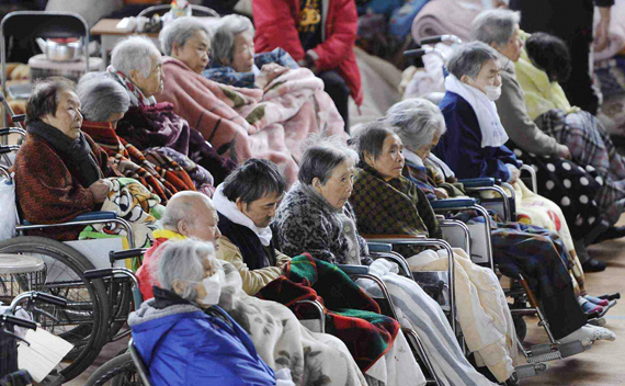 People on their wheelchairs rest at an evacuation centre in Kesennuma, Miyagi Prefecture in northern Japan, after an earthquake and tsunami struck the area, March 15, 2011.