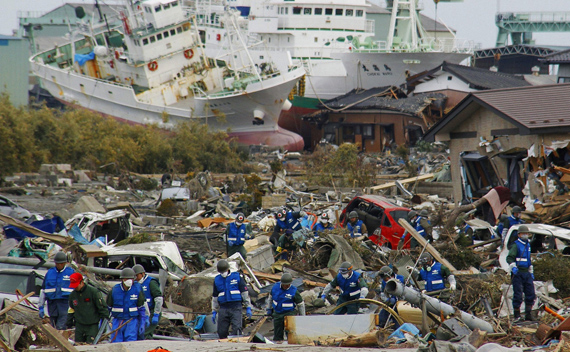 Japan Self-Defense Forces officers search for victims in Higashimatsushima City, Miyagi Prefecture in northern Japan, after an earthquake and tsunami struck the area, March 14, 2011.