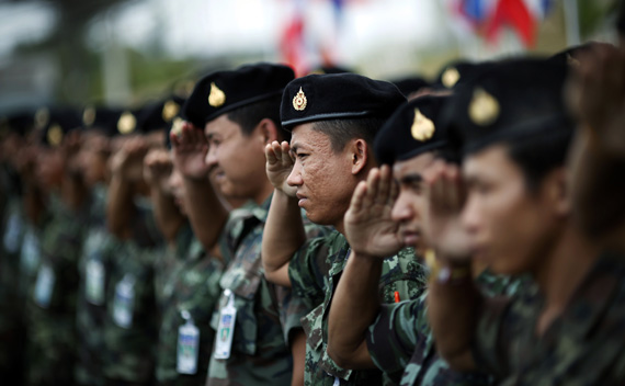 Thai soldiers salute as a coffin of their comrade killed in a recent car bombing is flown home from the troubled Yala province in southern Thailand March 2, 2011.