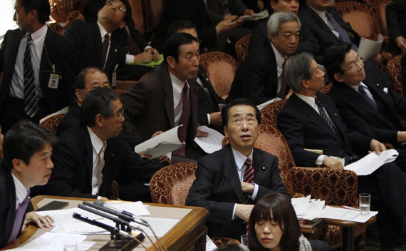 Japan's Prime Minister Naoto Kan reacts he he feels an earthquake in the upper house of parliament in Tokyo on March 11, 2011.