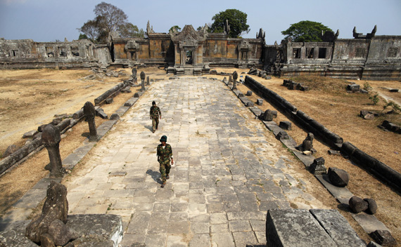 Cambodian soldiers walk at the 11th-century Preah Vihear temple on the border between Thailand and Cambodia February 9, 2011.