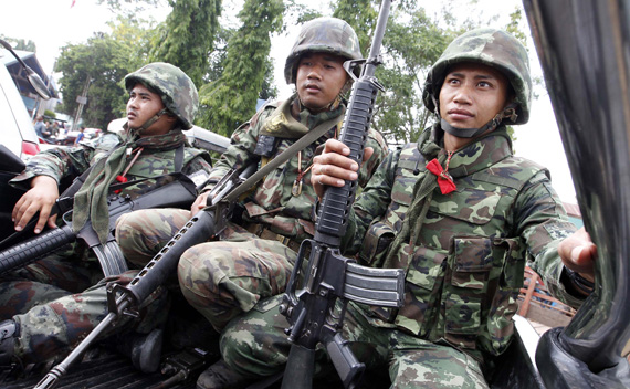 Thai soldiers are seen during a visit by Thai Prime Minister Abhisit Vejjajiva, following armed clashes on a disputed border area between Cambodia and Thailand, at a makeshift camp in Surin province, 30 km (19 miles) from the Thai-Cambodia border, April 27, 2011.