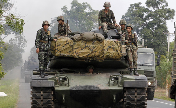 Thai army tanks travel on a road near the Thai-Cambodia border in Surin province April 28, 2011.