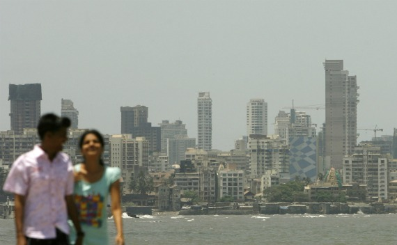 A couple walk at the seafront in Mumbai on May 11, 2009.