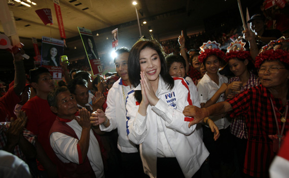 Yingluck Shinawatra is welcomed by her supporters during an election campaign in Chiang Mai province