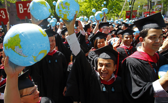 Students from Harvard Kennedy School cheer as they receive their degrees during the 360th Commencement Exercises at Harvard University in Cambridge, Massachusetts May 26, 2011.