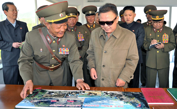 North Korean leader Kim Jong-il (front R), his son and vice-chairman of the Central Military Commission of the Workers' Party of Korea, Kim Jong-un (2nd R, 2nd row) and other officials visit the construction site of the Huichon Power Station in this picture released by the North's official KCNA news agency in Pyongyang June 1, 2011.
