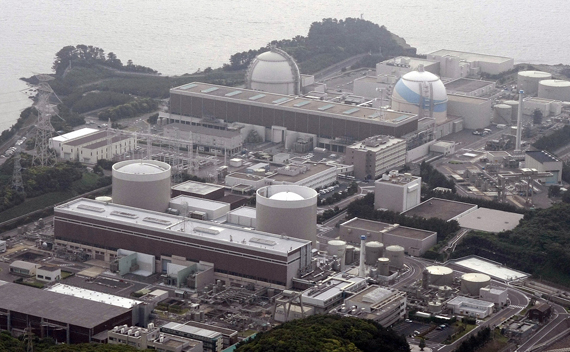 An aerial view shows Kyushu Electric Power's Genkai nuclear power plant, in Genkai town, Saga Prefecture, in this picture taken by Kyodo on June 9, 2011. The Japanese government moved closer on Wednesday to securing approval from local authorities to restart the first of 35 nuclear reactors shut for regular maintenance or kept idle since the March earthquake and tsunami. Japan's trade and energy minister, undeterred by several dozen anti-nuclear protesters urging him to go home, tried to persuade local governments in the southern Saga prefecture that it was safe to restart nuclear reactors shut since a deadly natural disaster struck the country's northeast on March 11.