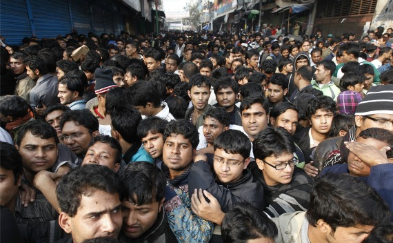 People gather in front of City Bank to buy tickets for the cricket World Cup in Dhaka on January 2, 2011.